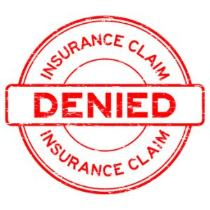 Grunge red insurance claim denied round rubber seal stamp