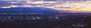 Panoramic sunset of Salt Lake City with snow capped Wasatch Mountains