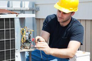 Repairman handling a HVAC