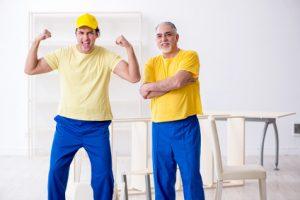 Two repairmen happy after using home hacks