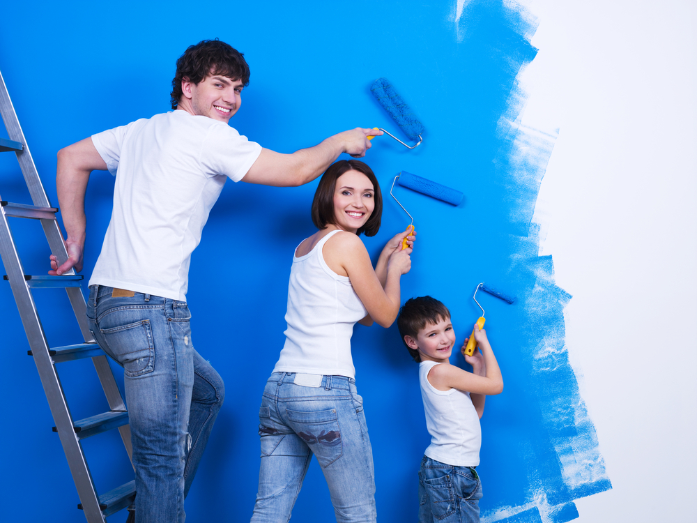 Family painting a wall DIY